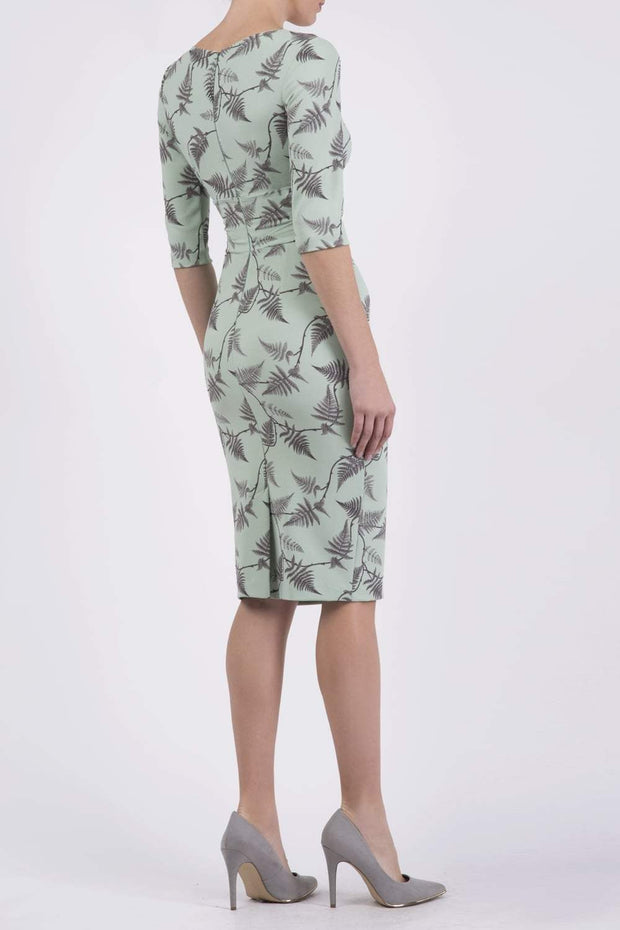 Model wearing the Diva Cynthia Print dress with pleating across the front in deco green fern back image