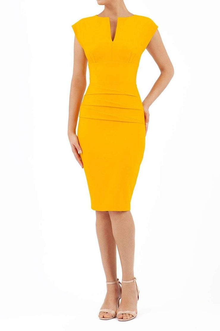 model wearing diva catwalk daphne sleeveless yellow pencil dress with rounded neckline with split in the middle in front