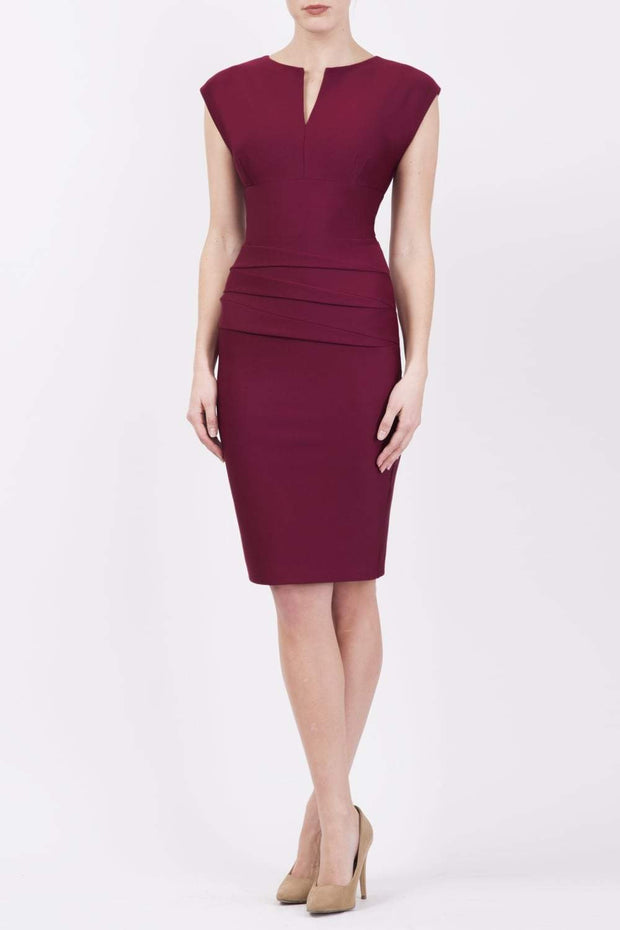 model wearing diva catwalk daphne sleeveless burgundy pencil dress with rounded neckline with split in the middle in wine colour front