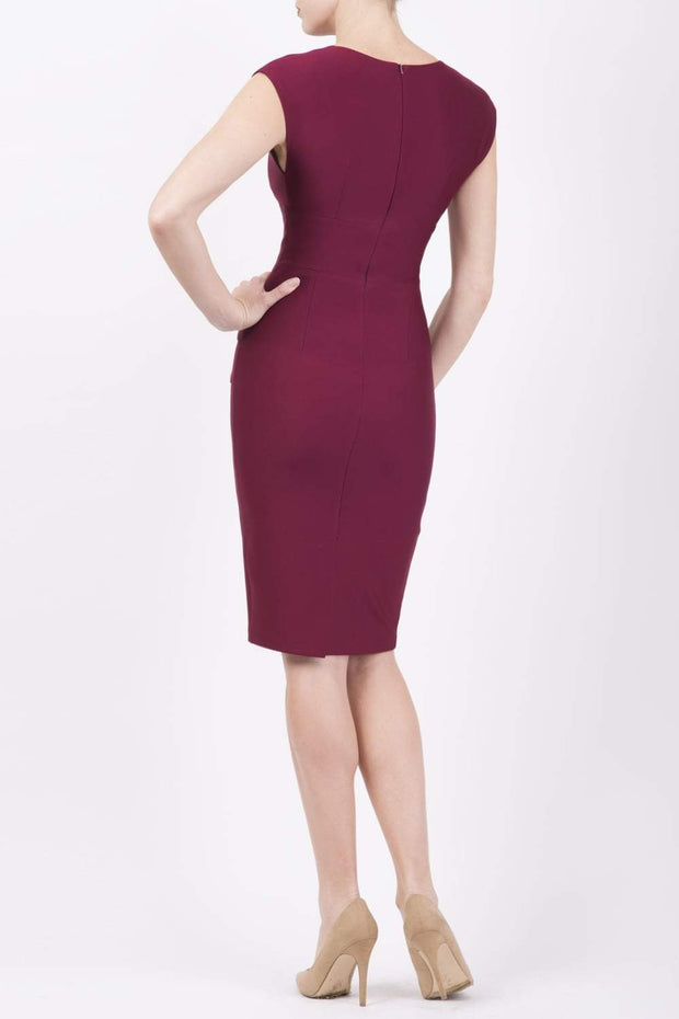 model wearing diva catwalk daphne sleeveless burgundy pencil dress with rounded neckline with split in the middle in wine colour back