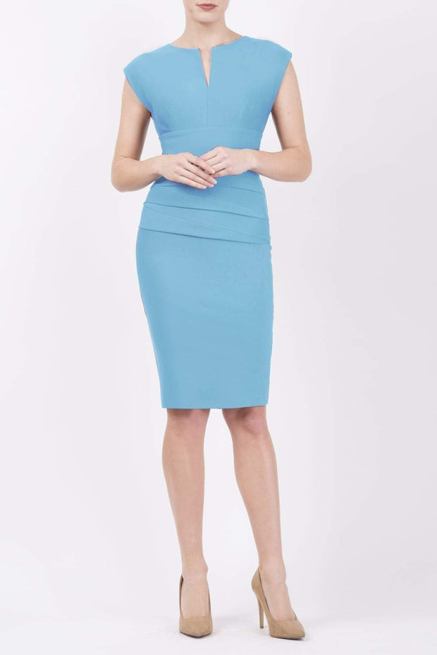 Model wearing the Diva Daphne Pencil with split neckline, sleeveless in sky blue front image