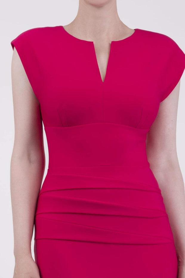 model wearing diva catwalk daphne sleeveless pink pencil dress with rounded neckline with split in the middle in front