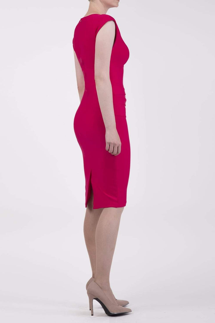 model wearing diva catwalk daphne sleeveless pink pencil dress with rounded neckline with split in the middle in side