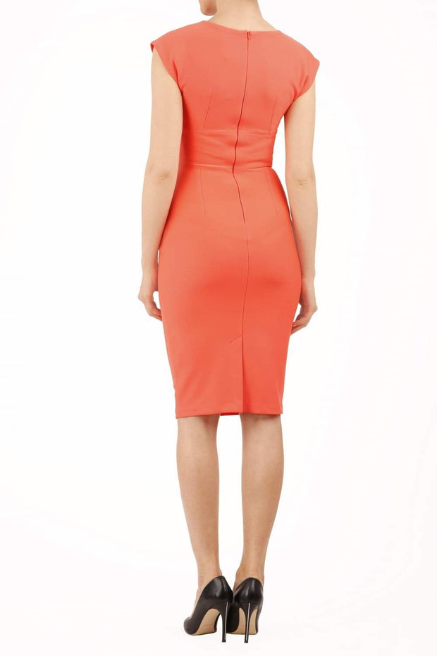 model wearing diva catwalk daphne sleeveless peach pencil dress with rounded neckline with split in the middle in back