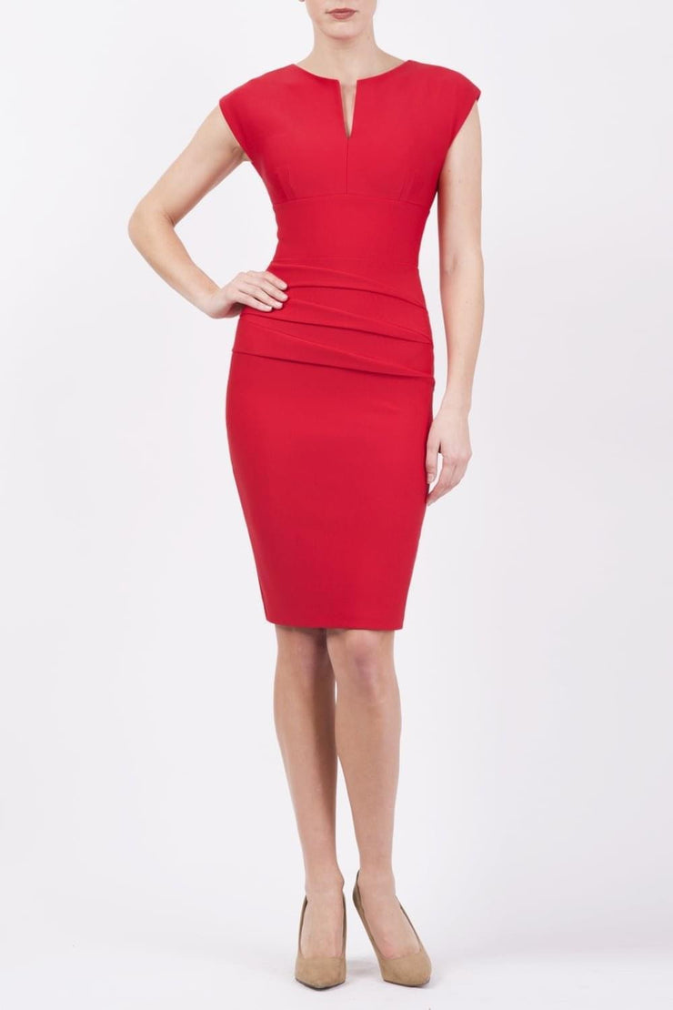 model wearing diva catwalk daphne sleeveless red pencil dress with rounded neckline with split in the middle in front