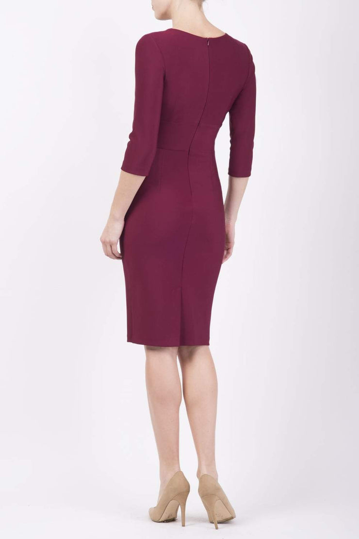 Model wearing the Diva Daphne ¾ Sleeved dress with pleat detail across the hips and ¾ sleeve length in blissful burgundy back image