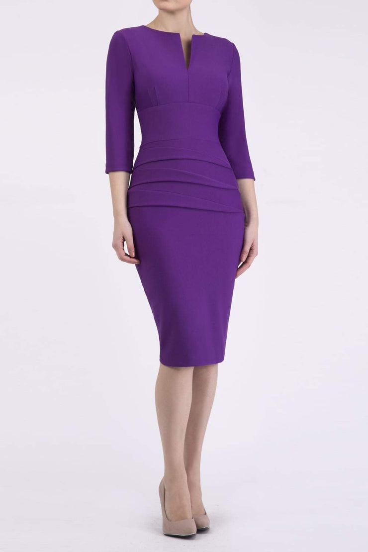 Model wearing the Diva Daphne ¾ Sleeved dress with pleat detail across the hips and ¾ sleeve length in royal purple front