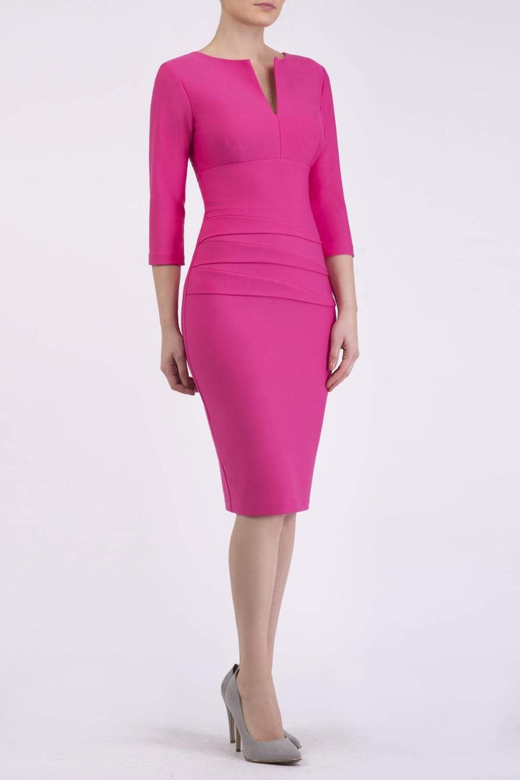 Model wearing the Diva Daphne ¾ Sleeved dress with pleat detail across the hips and ¾ sleeve length in hibiscus pink front image