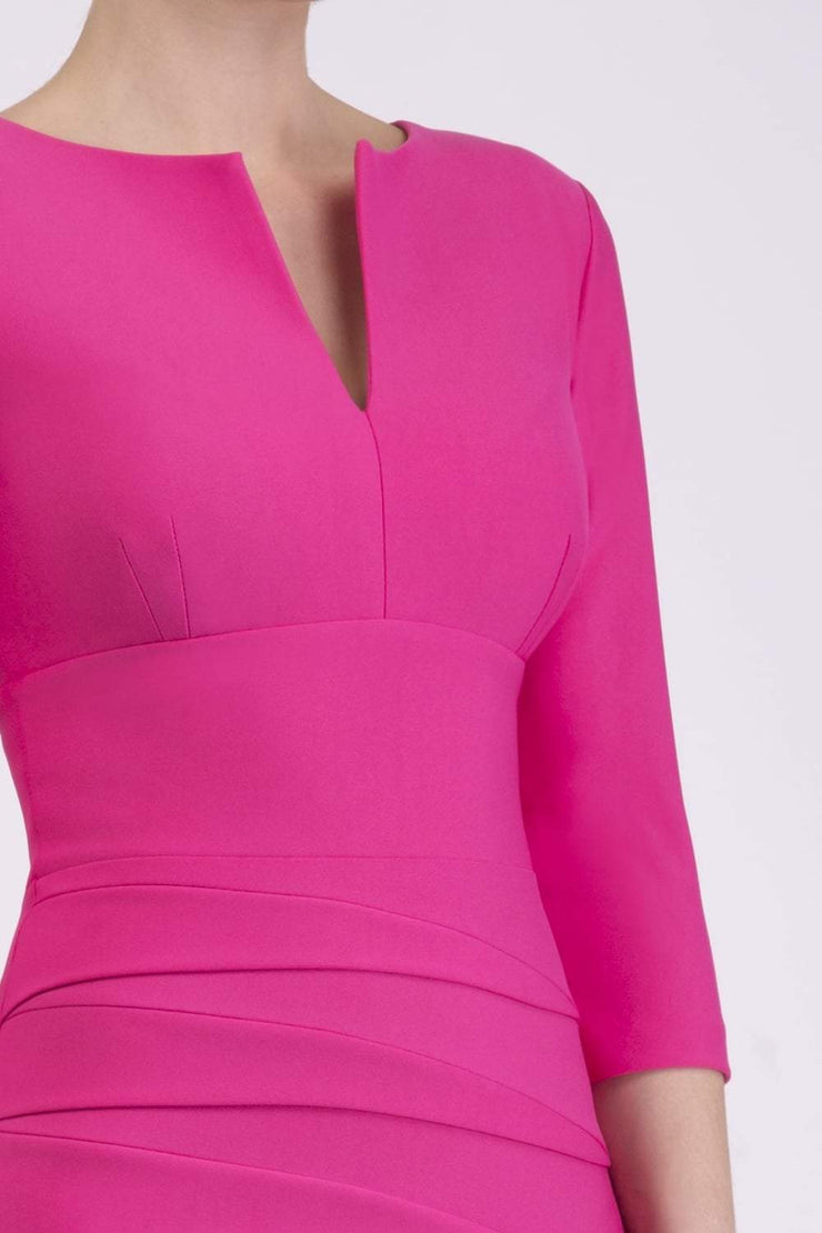 Model wearing the Diva Daphne ¾ Sleeved dress with pleat detail across the hips and ¾ sleeve length in hibiscus pink front