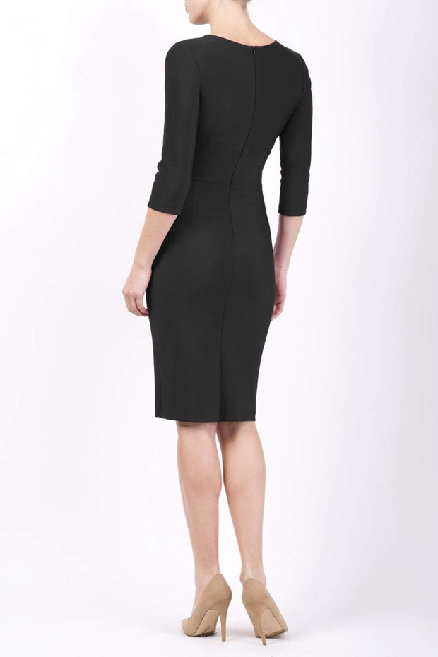 Model wearing the Diva Daphne ¾ Sleeved dress with pleat detail across the hips and ¾ sleeve length in black back