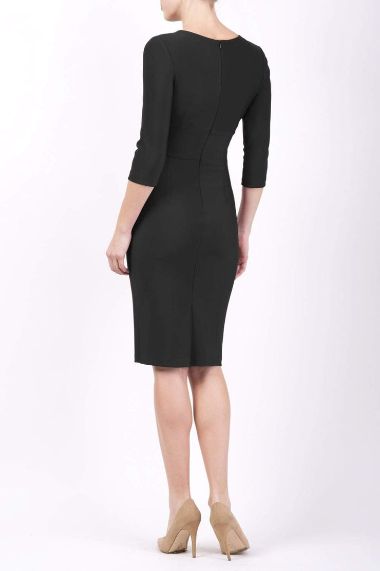 Model wearing the Diva Daphne ¾ Sleeved dress with pleat detail across the hips and ¾ sleeve length in black back image