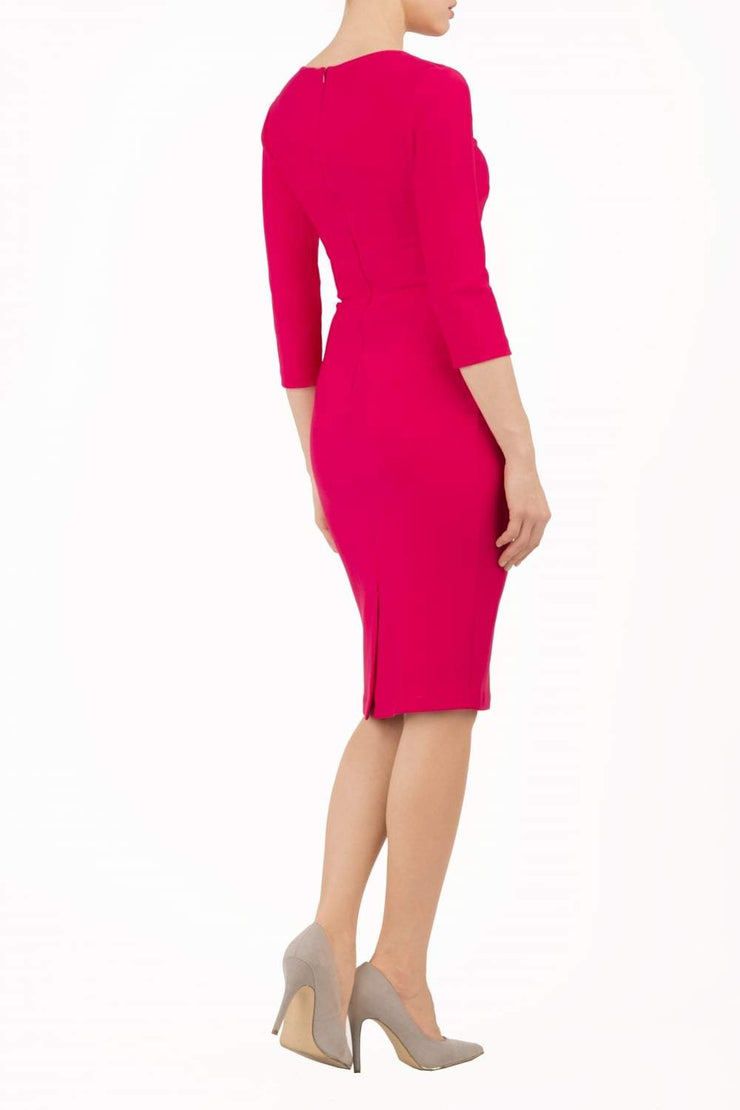 Model wearing the Diva Daphne ¾ Sleeved dress with pleat detail across the hips and ¾ sleeve length in yarrow pink back image