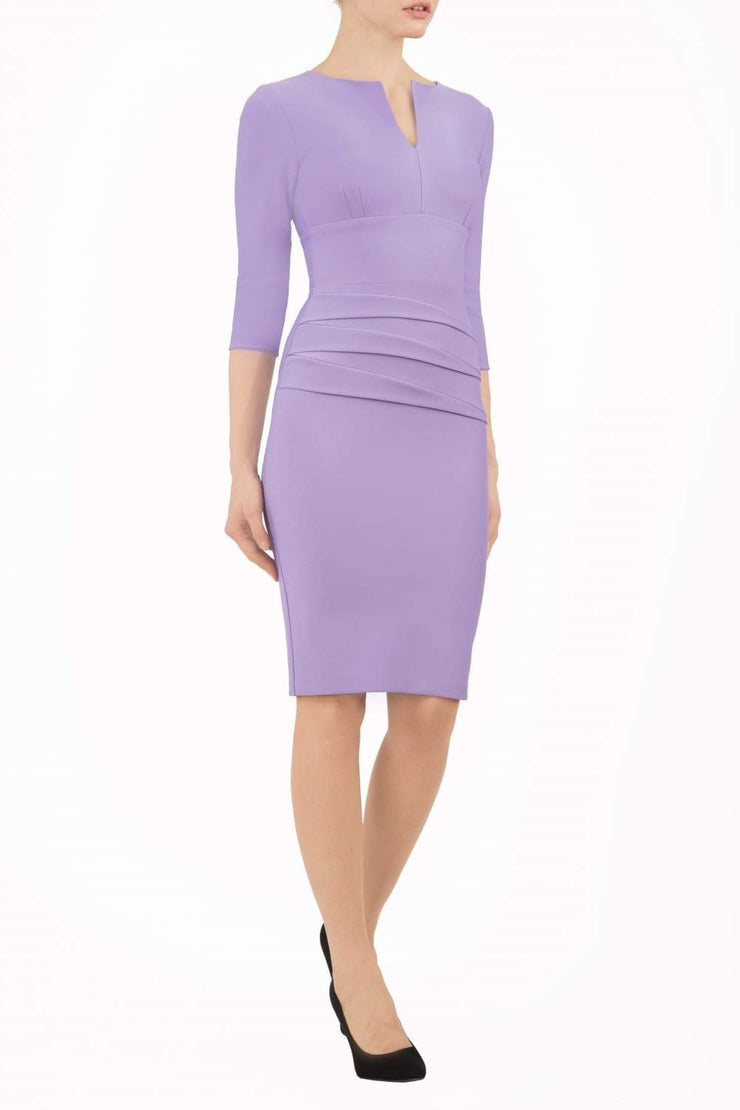 Model wearing the Diva Daphne ¾ Sleeved dress with pleat detail across the hips and ¾ sleeve length in lilac wisteria front image