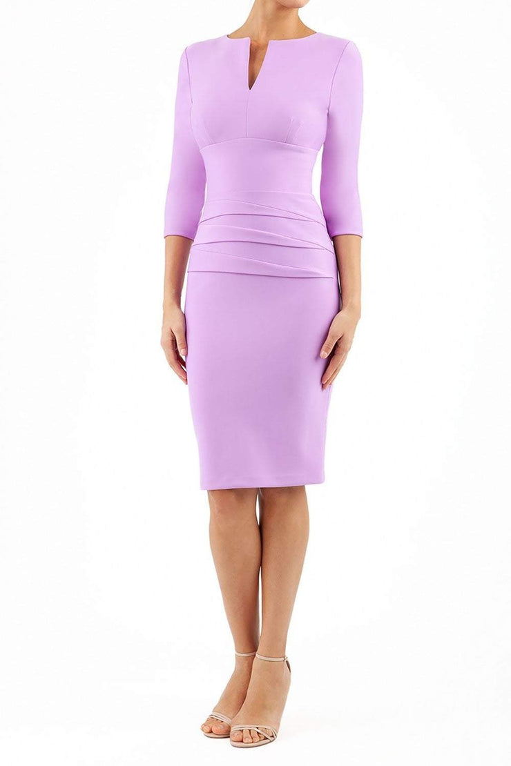 Model wearing the Diva Daphne ¾ Sleeved dress with pleat detail across the hips and ¾ sleeve length in violet bloom front