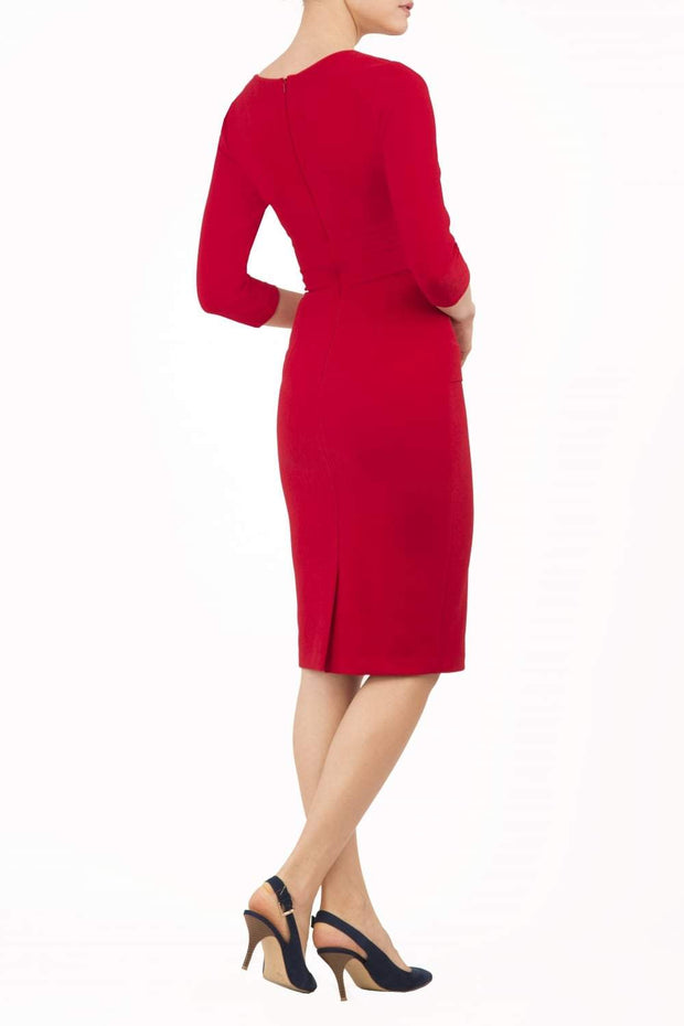 Model wearing the Diva Daphne Venice Stretch Pencil dress with pleat detail across the front in tango red back image