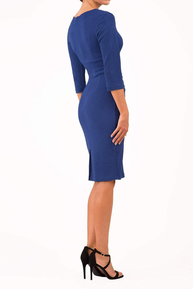 Model wearing the Diva Daphne Venice Stretch Pencil dress with pleat detail across the front in midnight blue back image