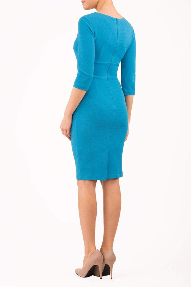 Model wearing the Diva Daphne Venice Stretch Pencil dress with pleat detail across the front in malibu blue back image