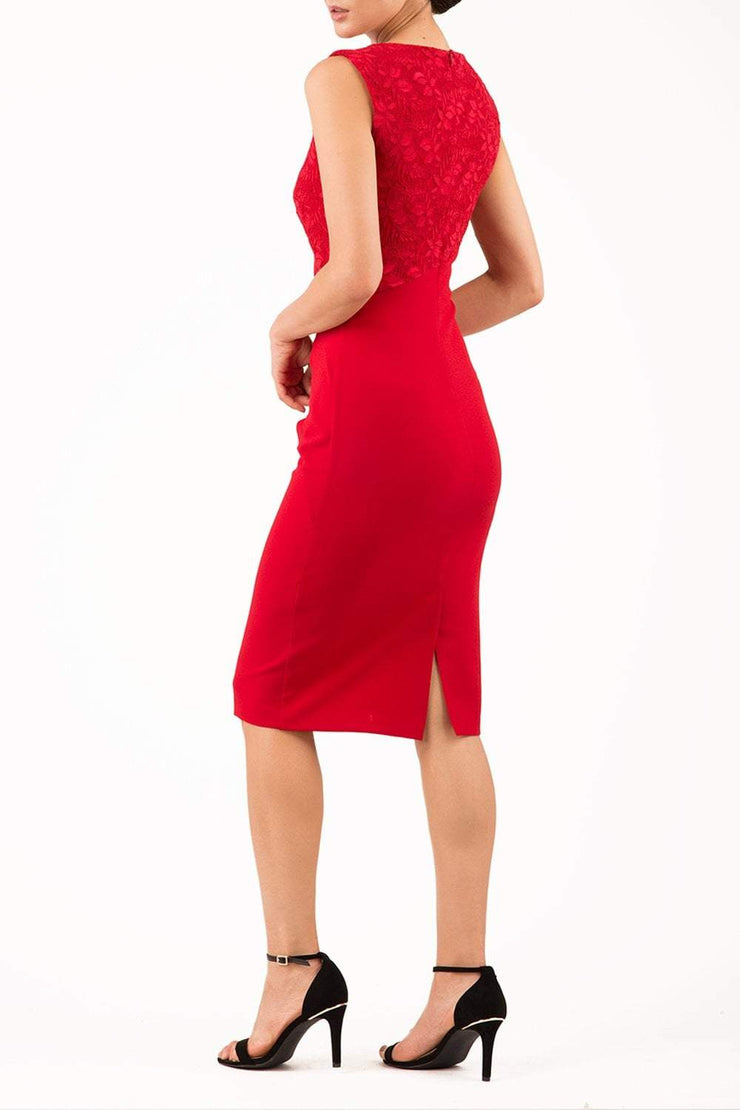 Model wearing the Diva Demelza Lace Pencil dress with lace stretch detailing and round neckline in passion red back image