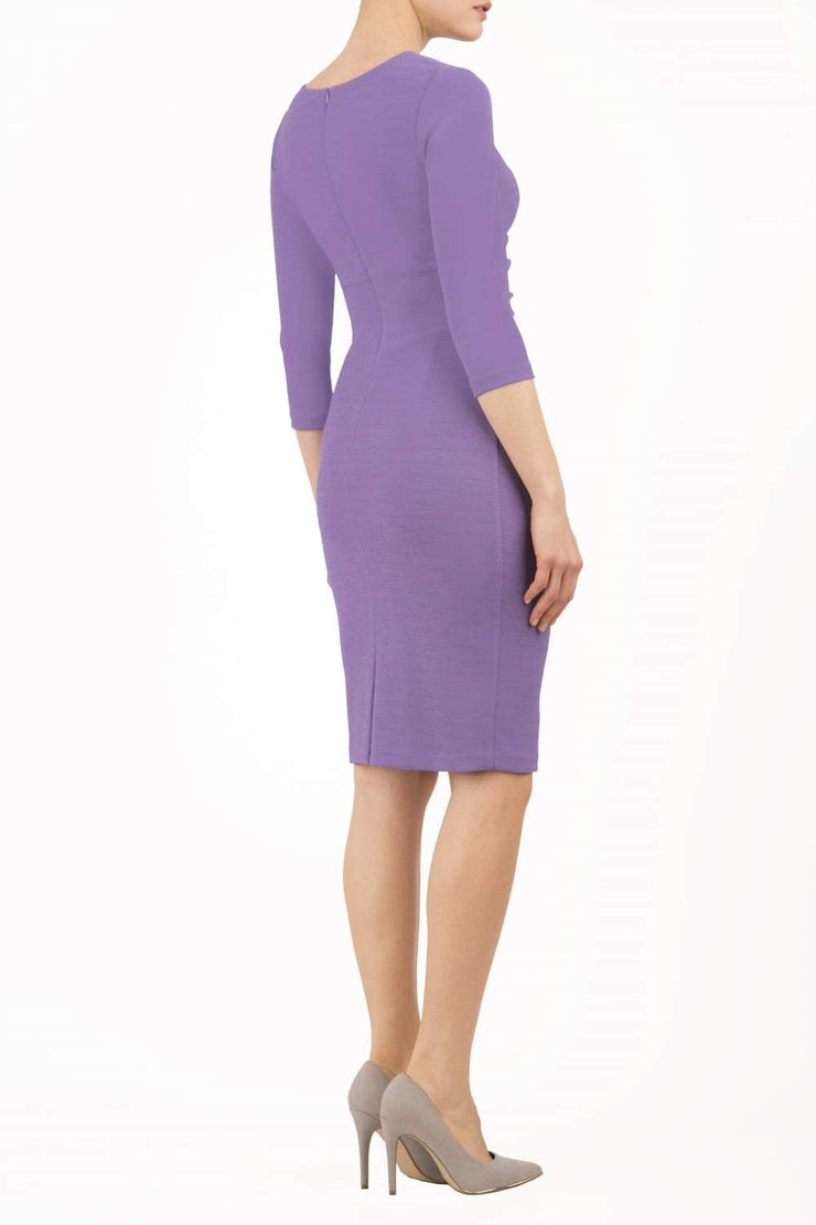 model wearing diva catwalk donna pencil dress in colour purple with wide band and sleeves and rounded neckline with low split in front back