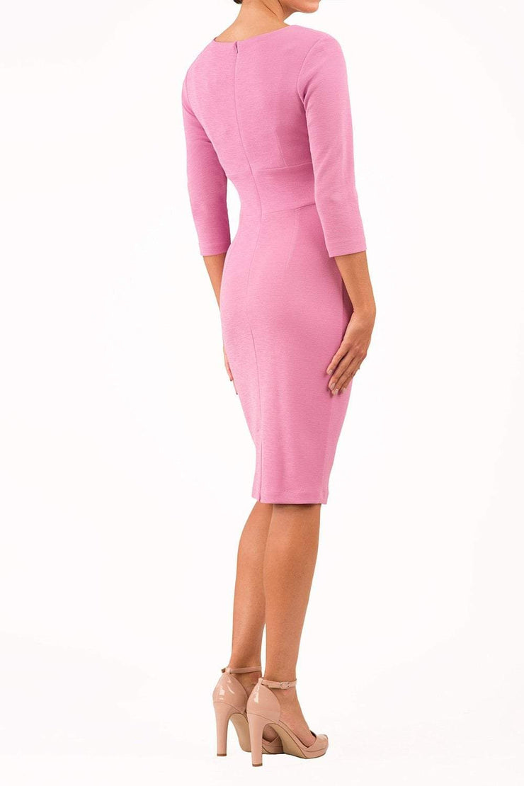 model wearing diva catwalk donna pencil dress in colour pink with wide band and sleeves and rounded neckline with low split in front back