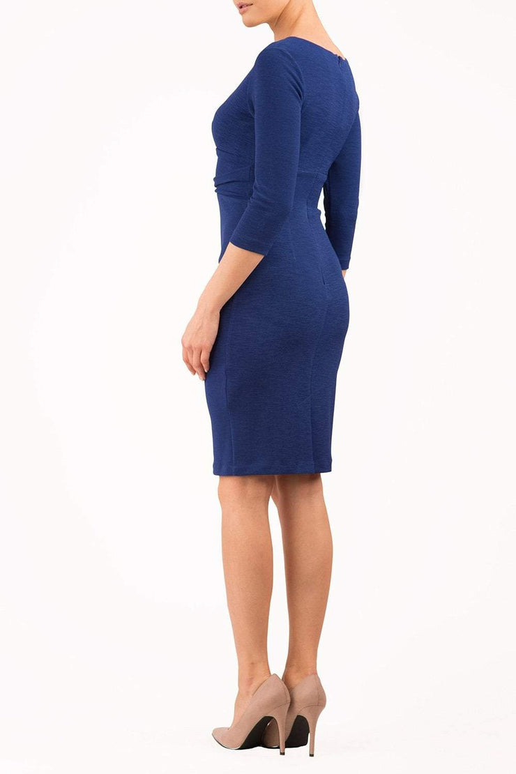 model wearing diva catwalk donna pencil dress in colour navy with wide band and sleeves and rounded neckline with low split in front back
