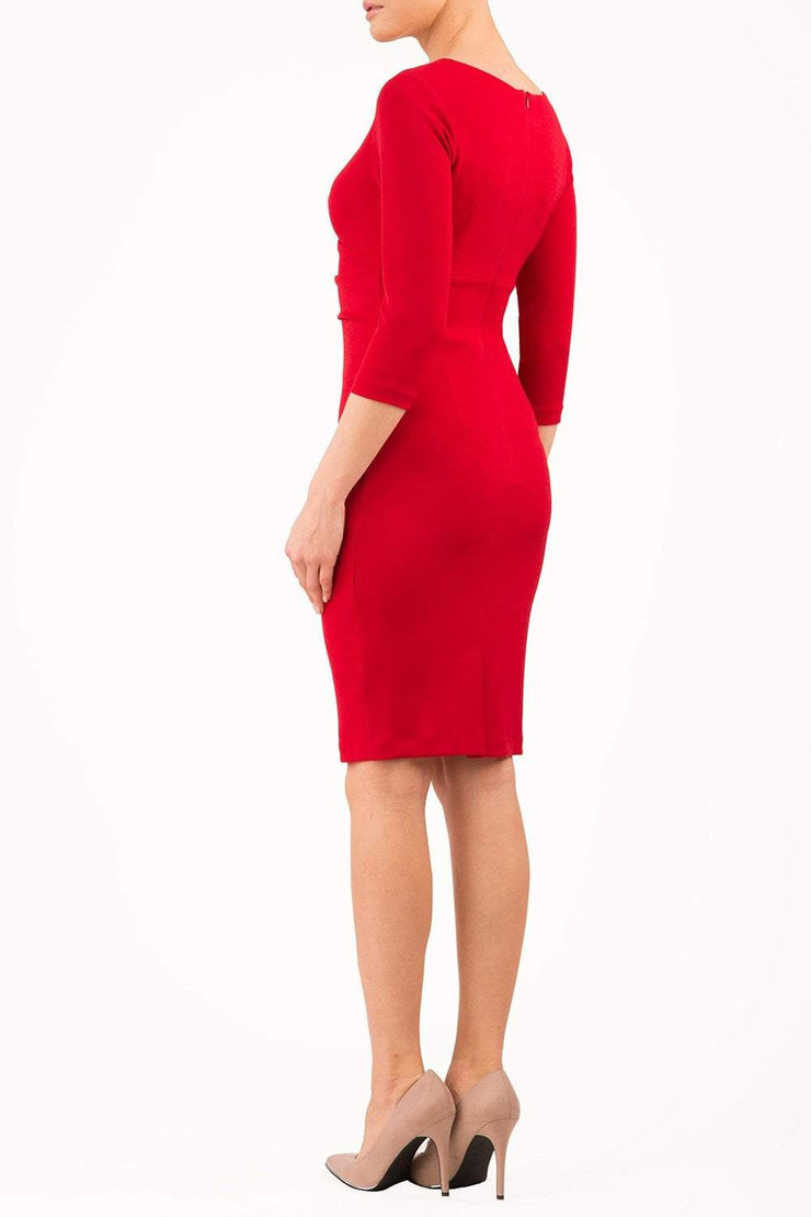 model wearing diva catwalk donna pencil dress in colour red with wide band and sleeves and rounded neckline with low split in front back