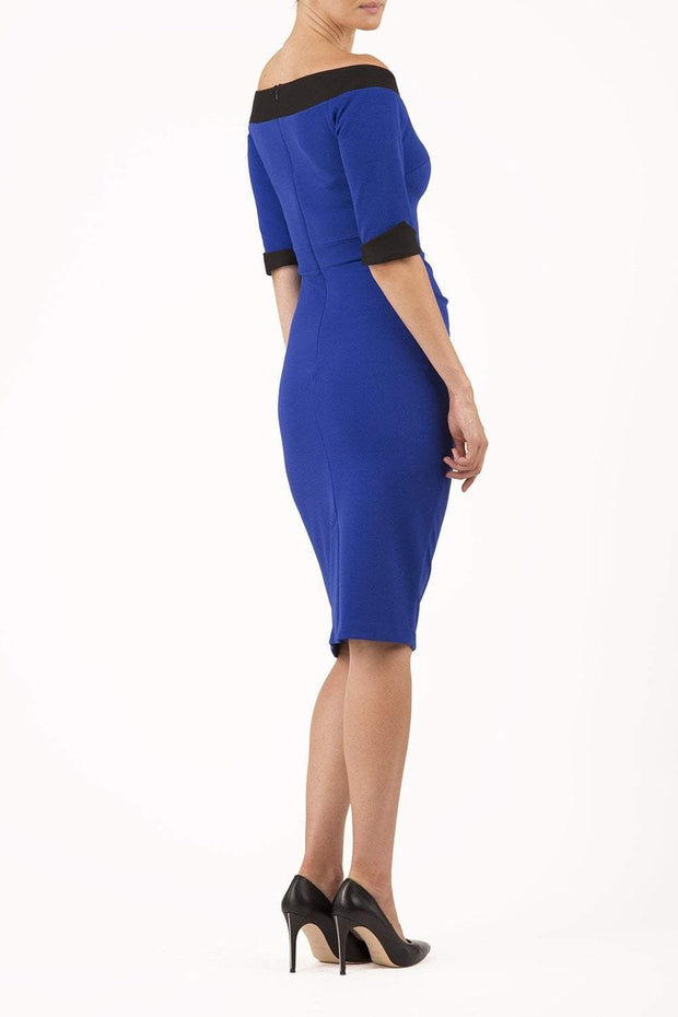 blonde model is wearing diva catwalk fellini sweetheart neckline fitted pencil dress with sleeves with cuff in colour royal blue with black contrasting detail back