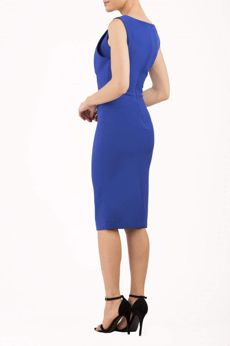 Model wearing the Diva Furlong dress in pencil dress design in royal blue backi mage
