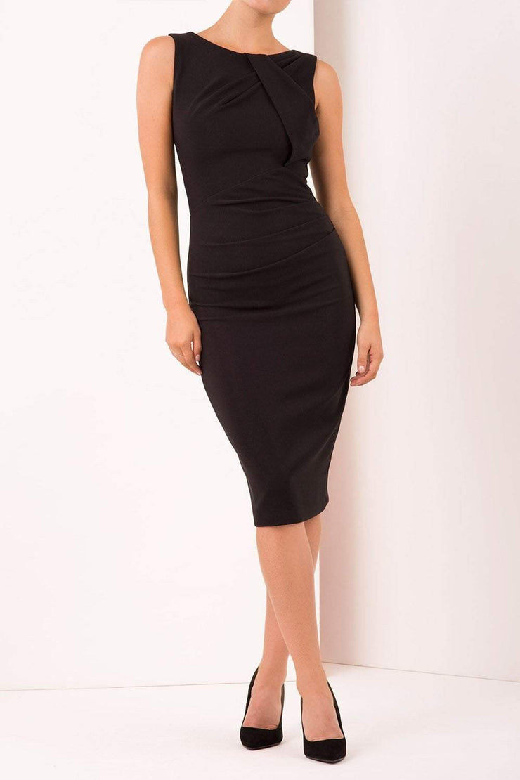 Model wearing the Diva Furlong dress in pencil dress design in black front image