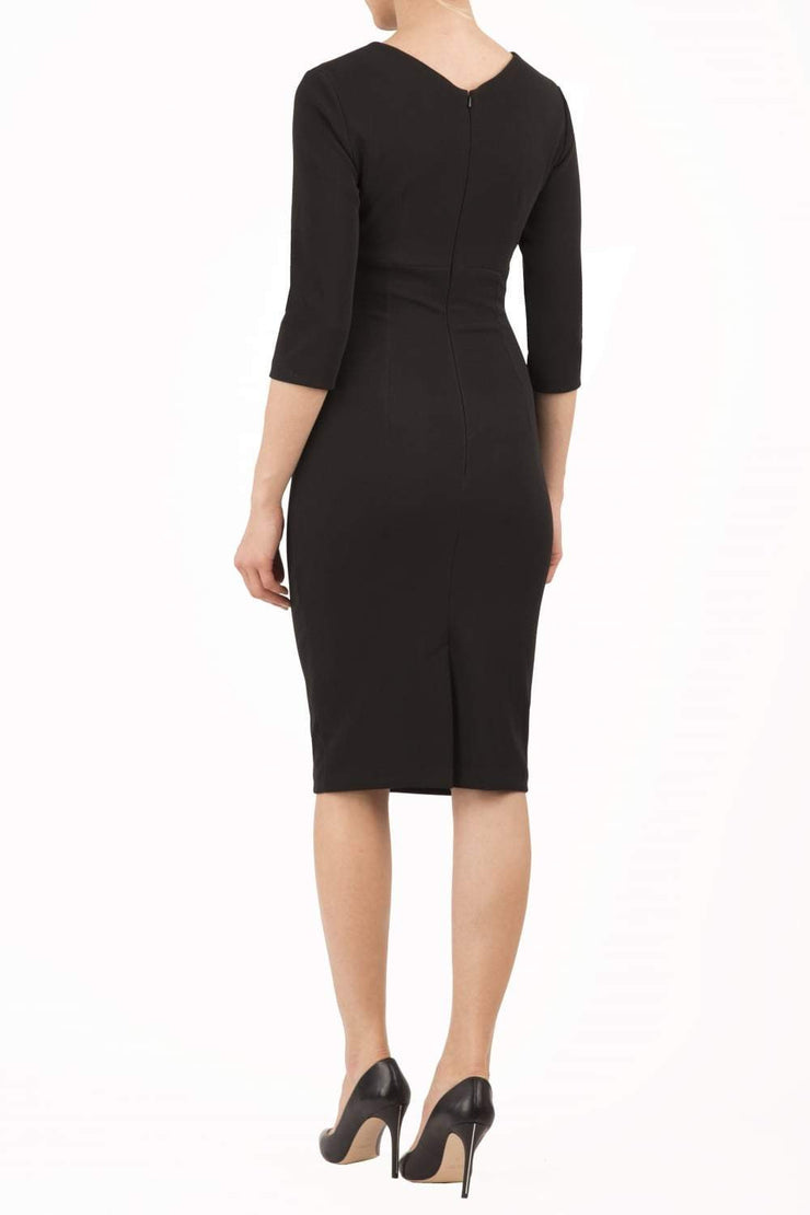 model wearing diva catwalk helston black pencil skirt  dress with sleeves and cut out detail on the neckline back