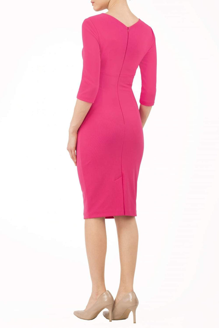 model wearing diva catwalk helston pink pencil dress with sleeves and cut out detail on the neckline back
