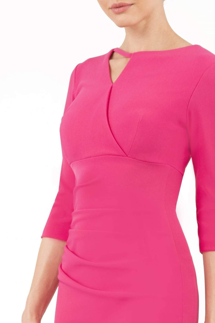 model wearing diva catwalk helston pink pencil dress with sleeves and cut out detail on the neckline front