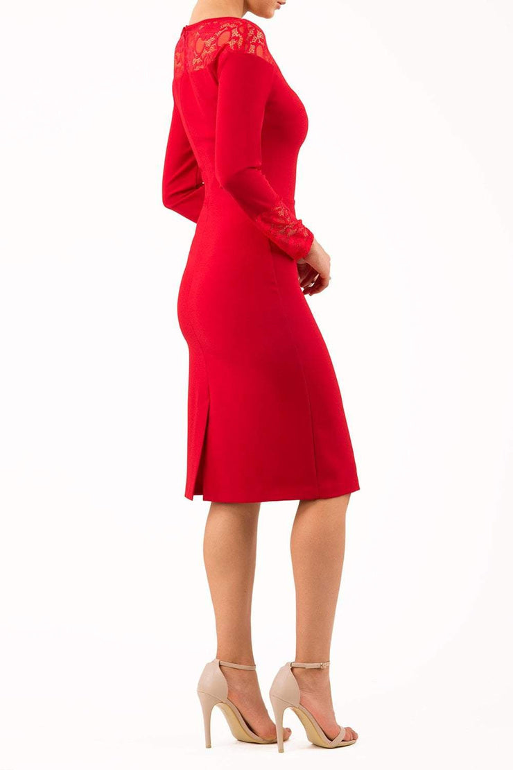 brunette model wearing diva catwalk red lace pencil dress with long sleeves and rounded lace neckline with the lace covering shoulders front