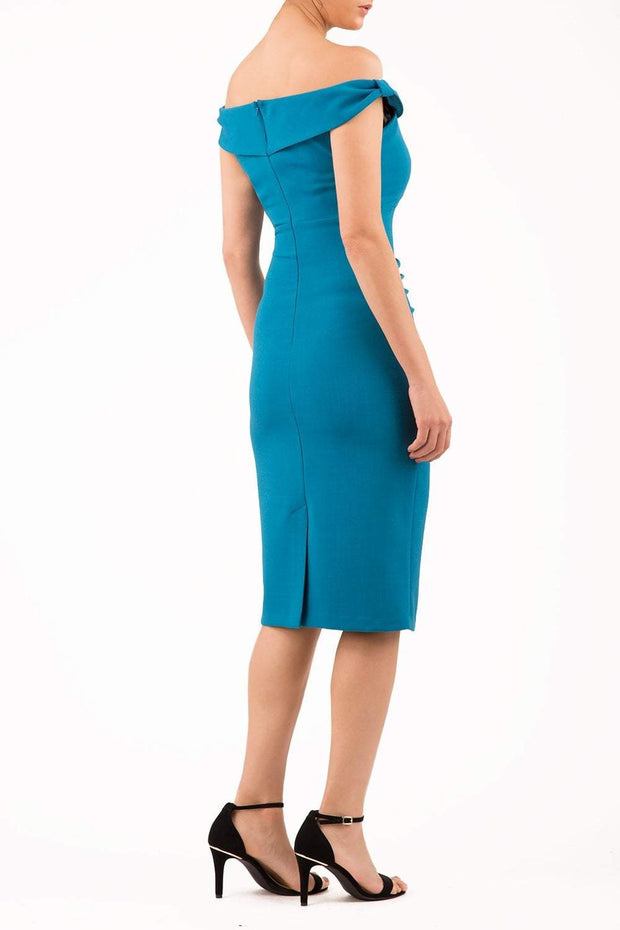 Model wearing the Diva Cloud Luxury Moss Crepe dress with cold shoulder design in teal back image