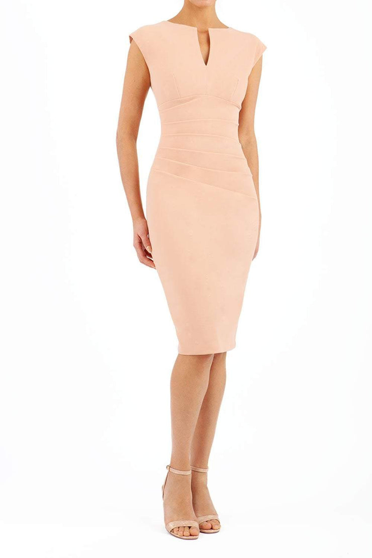 Model wearing Diva Catwalk Lydia Classic Sleeveless Bodycon Pencil Dress rounded neckline with slit in Almond Mousse front