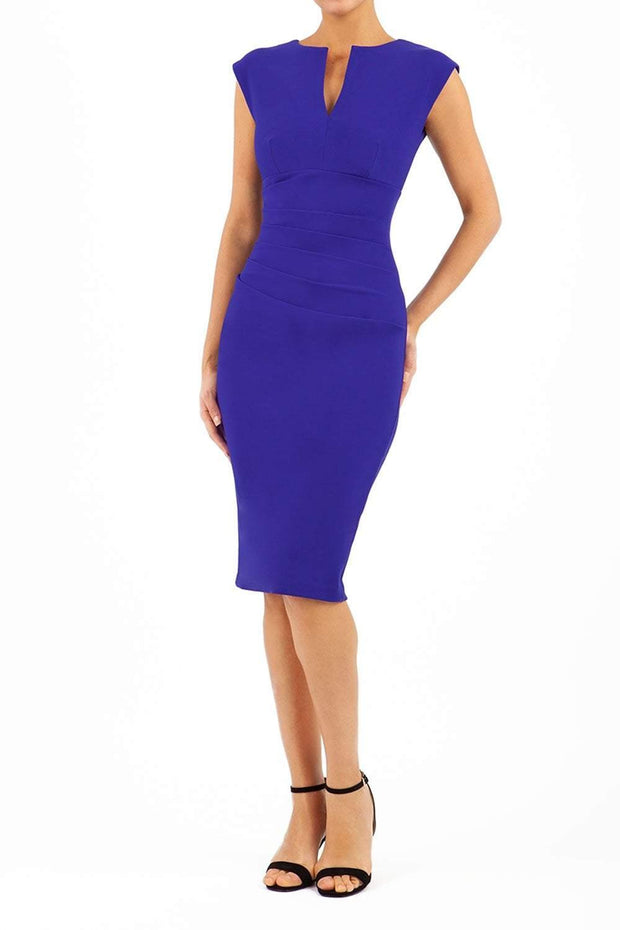Model wearing Diva Catwalk Lydia Classic Sleeveless Bodycon Pencil Dress rounded neckline with slit in Deep Orient Blue front