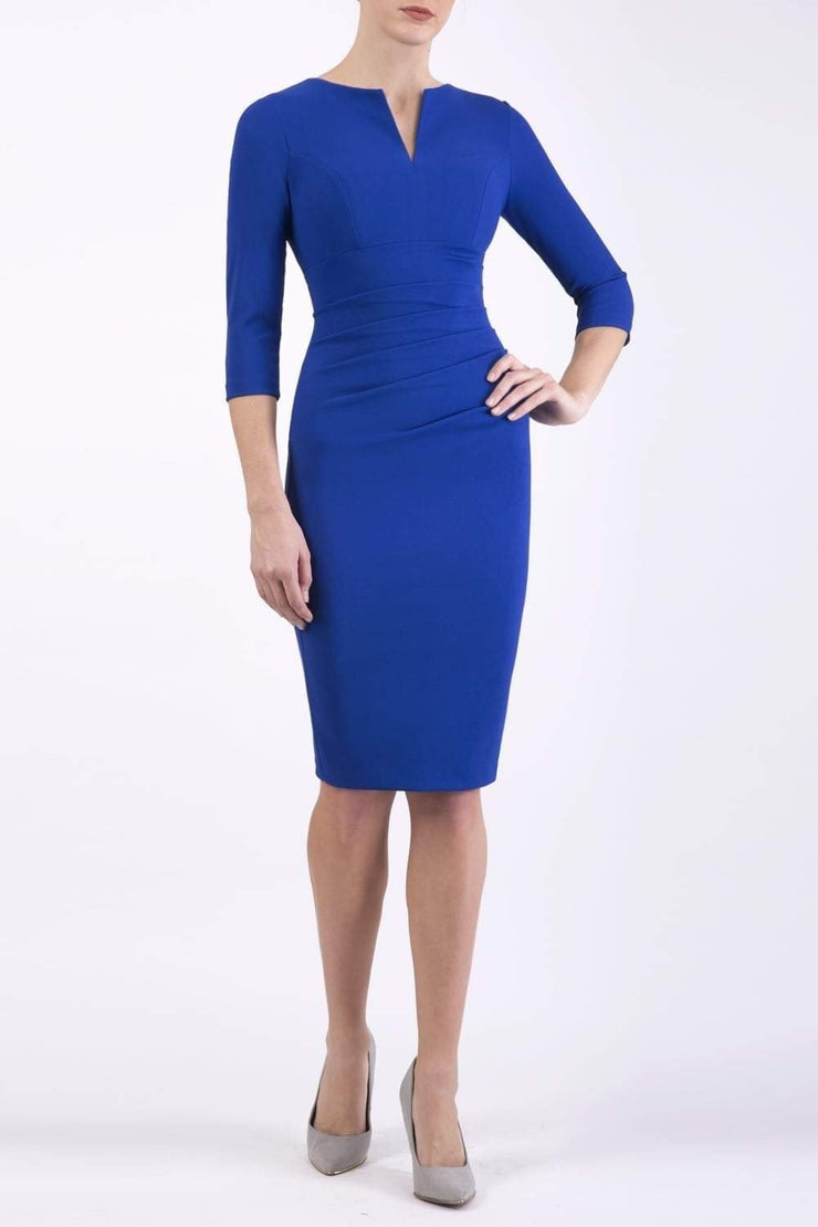 model wearing Diva Catwalk pencil three quarter sleeve dress with a split neckline and pleating across the tummy in Cobalt Blue front