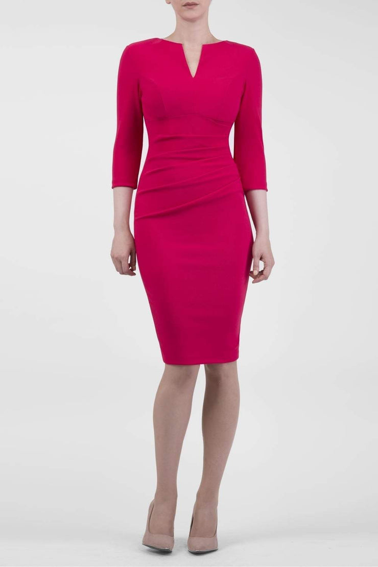 brunette model wearing diva catwalk best selling lydia pencil sleeved dress with slit at the neckline and pleating across the tummy in colour raspberry pink front