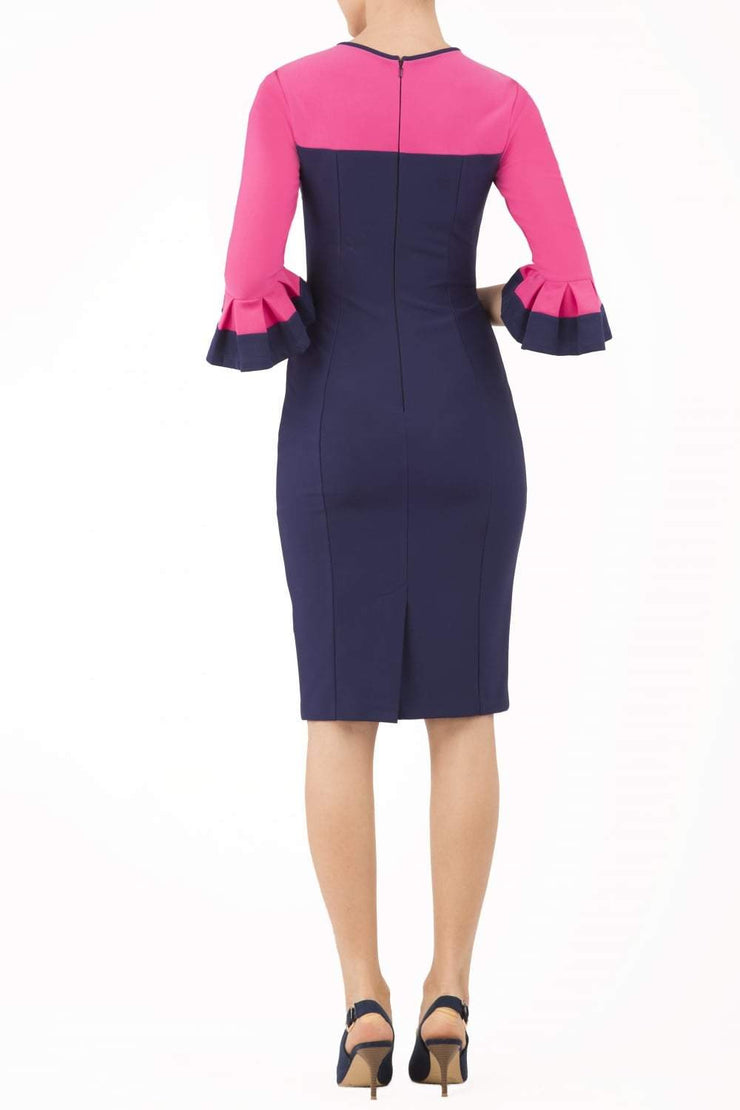 Model wearing the Diva Lyonia Pencil dress in pencil dress design in navy blue and fucshia pink front image