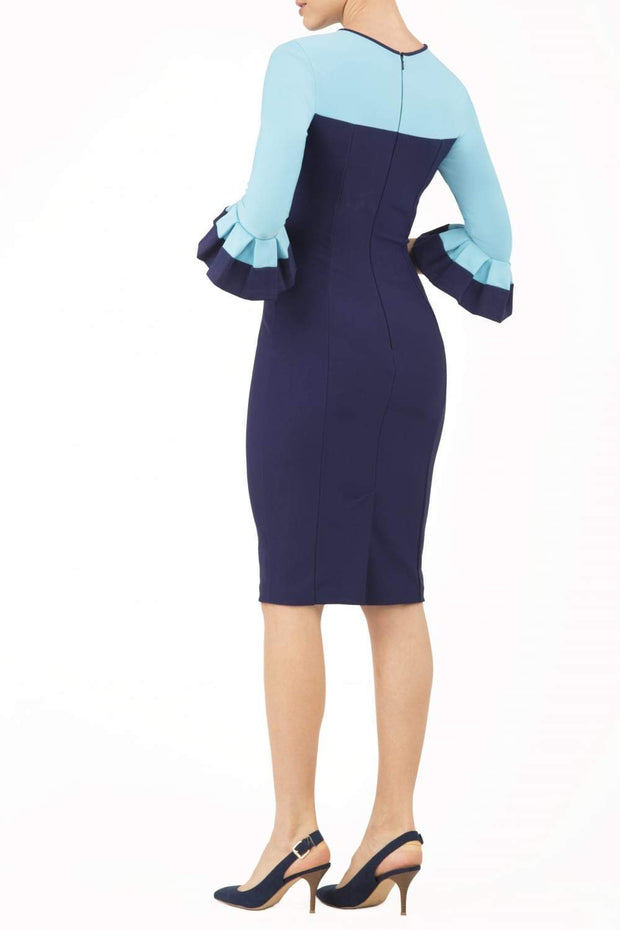 Model wearing the Diva Lyonia Pencil dress in pencil dress design in navy blue and sky blue back image