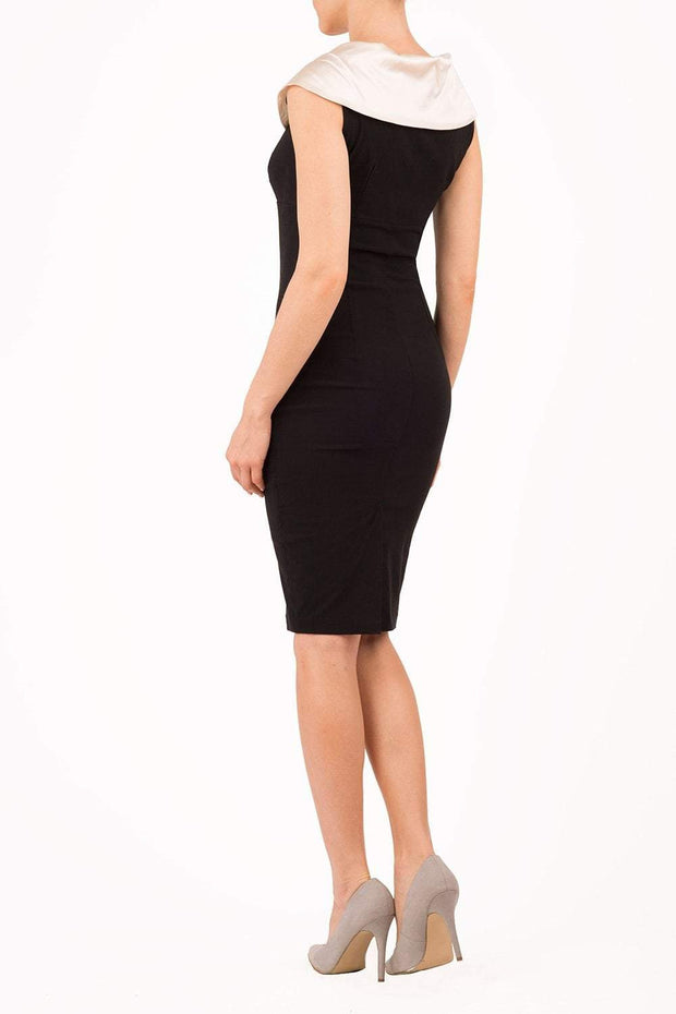 Model wearing the Diva Marlborough dress in pencil dress design in black and ivory colour back image