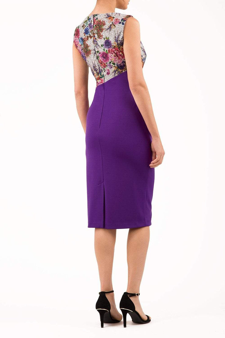 Model wearing the Diva Demelza Matilda Jacquard dress with short sleeves, pencil fit in deep purple front image