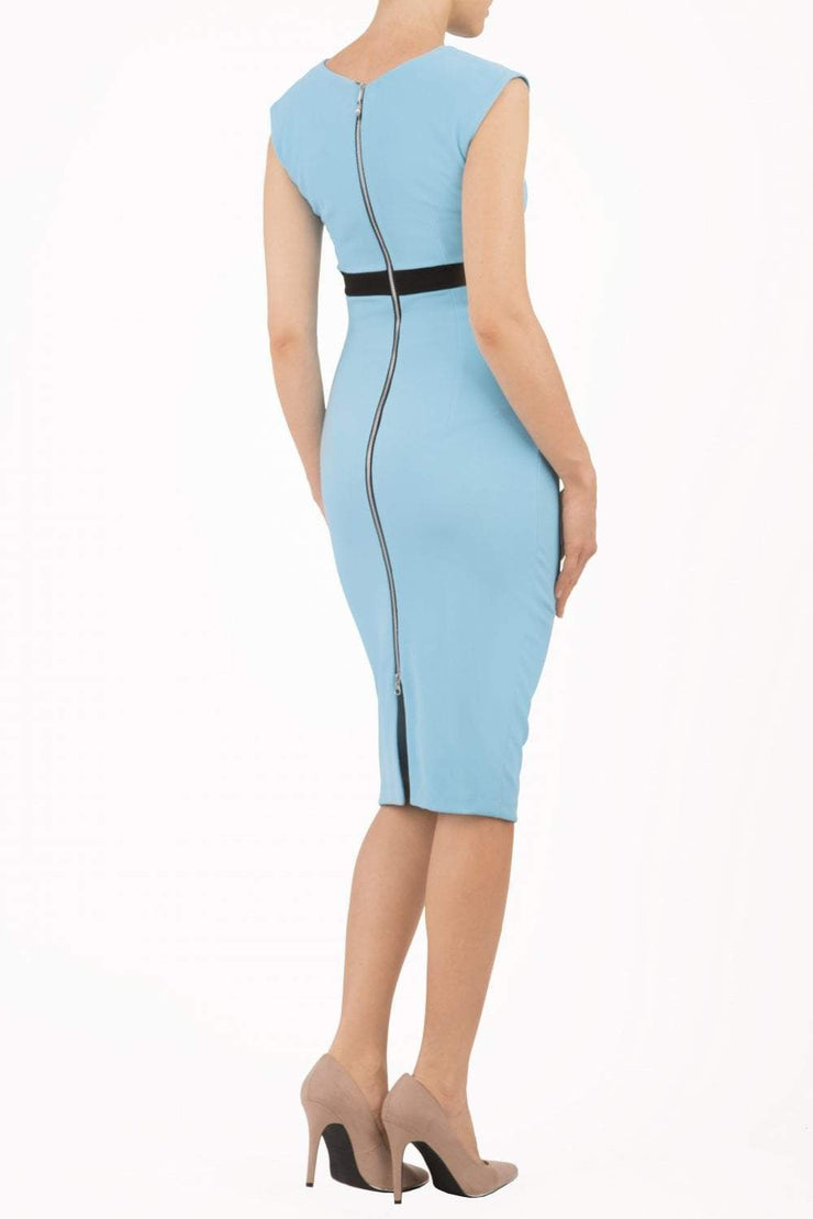 brunette model wearing diva catwalk nadia sleeveless pencil dress in sky blue colour with a contrasting black band and exposed zip at the back with a rounded neckline with a slit  in the middle back
