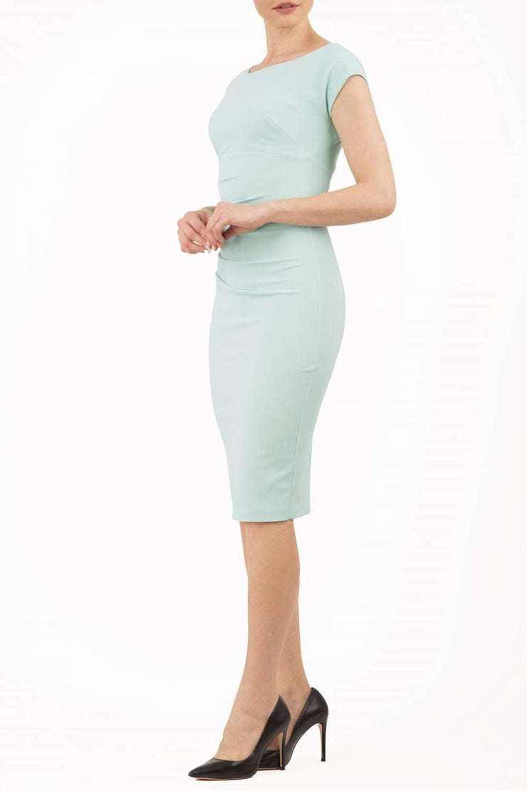 Model wearing Diva Catwalk Polly Rounded Neckline Pencil Cap Sleeve Dress with pleating across the tummy area in Mint Green front