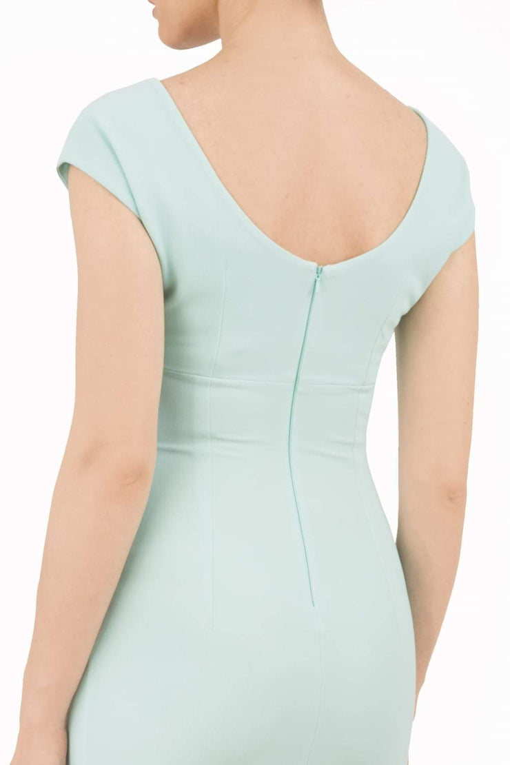Model wearing Diva Catwalk Polly Rounded Neckline Pencil Cap Sleeve Dress with pleating across the tummy area in Mint Green back