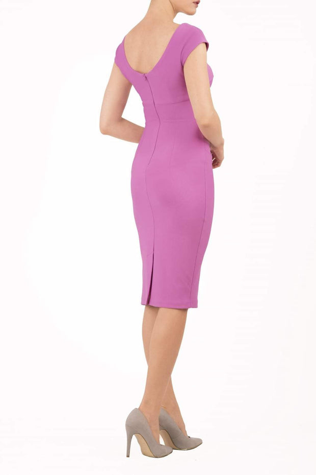 Model wearing Diva Catwalk Polly Rounded Neckline Pencil Cap Sleeve Dress with pleating across the tummy area in Rosebud Pink back