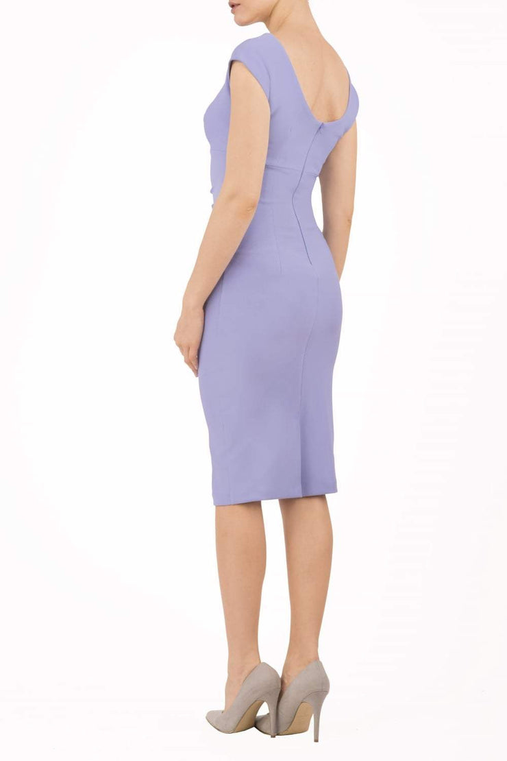 Model wearing Diva Catwalk Polly Rounded Neckline Pencil Cap Sleeve Dress with pleating across the tummy area in Vista Blue back