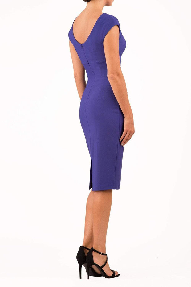 Model wearing Diva Catwalk Polly Rounded Neckline Pencil Cap Sleeve Dress with pleating across the tummy area in Deep Orient Blue back