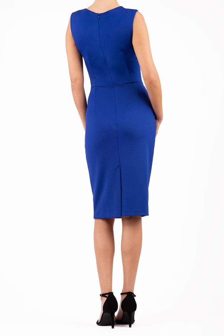 model wearing diva catwalk primula pencil skirt dress in pink with pleating on one side and sleeveless design in colour royal blue back