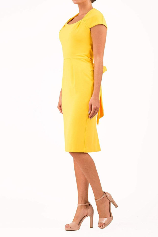 Amal_clooney_yellow_dress_royal_wedding_Harry_maghan_pencil_dress_side_image